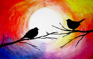 Zwei verliebte Vögel auf zwei Ästen