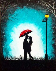 Liebespaar küsst sich unter dem Regenschirm